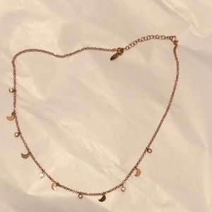 Rose gold p,aged necklace with delicate moons